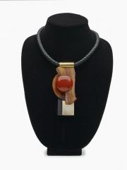 """(139M) 4 1/2"""" x 2"""" x 7/8"""" sedona sunrise slab, birdseye maple, jade, brass bale, leather cord"""
