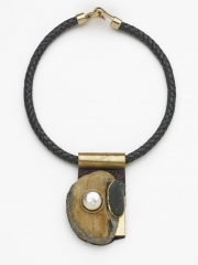 """(143)3 3/8"""" x 2 1/8"""" x 7/8 rock, baroque pearl, gold leaf, brass, cork, leather cord"""