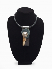 """(145M) 4 1/4"""" x 1 3/4"""" x 1"""" rock, sterling silver disk, baroque pear, cork, bone, stainless steel, leather cord"""
