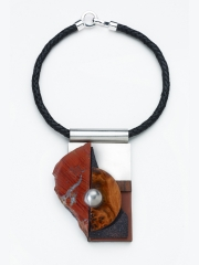 "(11) 4.75""x3.25""x1.0 red jasper slab, steel, cork, rubber, stainless steel dot, bocote wood, leather cord"