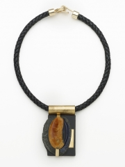 "(132) 2 7/8"" x 1 3/4"" x 3/4"" simbircite cabochon, granite, bronze wire, brass bale, leather cord"