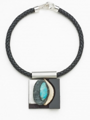 "(142) 2 3/4"" x 2 1/8"" x 7/8"" rock, turquoise, bone, stainless steel, leather cord"
